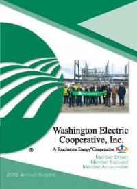 2019 Annual Report cover featuring co-op employees and board members holding a green ribbon in front of the Rouse substation
